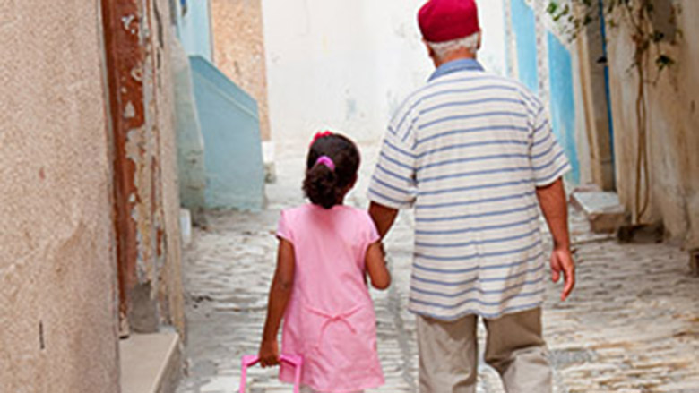 Grandfather and granddaughter walking back from school in Sousse, Tunisia. © Lyubov Timofeyeva | Shutterstock.com